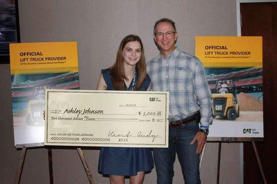 Kent Eudy, executive vice president of sales and marketing, Cat Lift Trucks, presented Ashley Johnson, the 2014 Cat Lift Trucks scholarship winner with a 5,000 scholarship for her higher education pursuits at Texas Tech University. Photo: Edelman