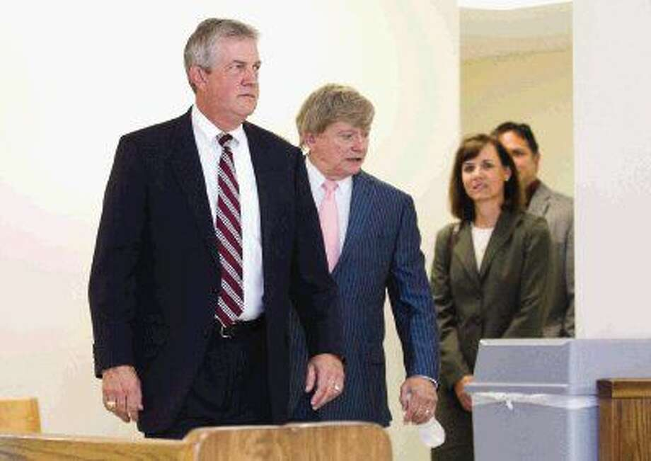 Montgomery County Judge Craig Doyal, left, walks toward the 221st state District Court with Houston defense attorney Rusty Hardin, followed by Doyal's wife Amy and Chief of Staff Jim Fredricks before an arraignment hearing Friday in Conroe. A trial date for all four is set for Nov. 7.