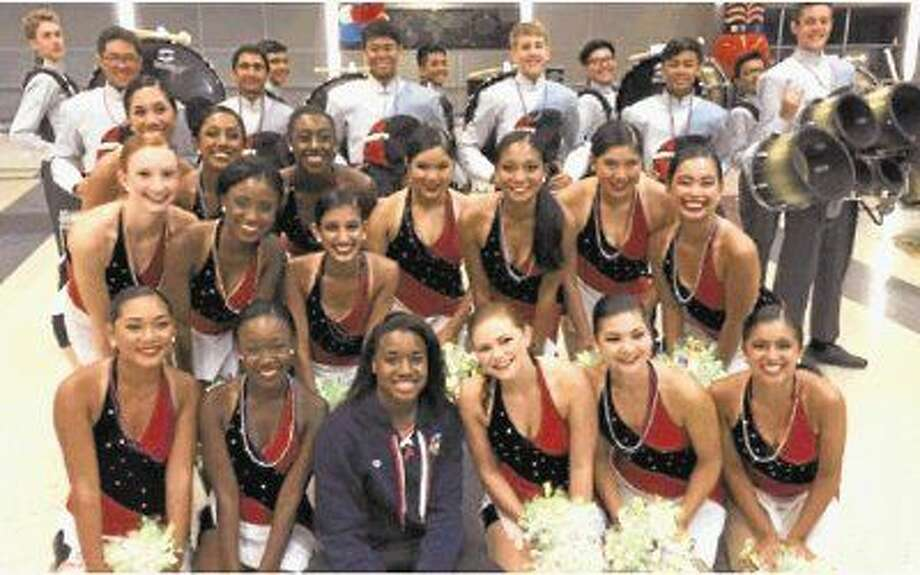 "U.S. Olympic Swimmer Simone Manuel received a ""Bulldog"" welcome from Austin High School Angels Dance Team and Drumline at Intercontinental Airport. Photo: Fort Bend ISD"
