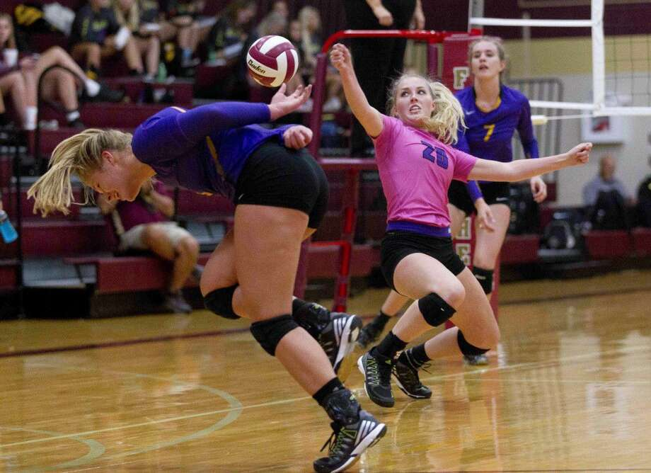 Montgomery libero Hannah Shinn (20) and outside hitter Lauren Endres (5) try to make a diving save as outside hitter Addison Barron (7) looks on during the first set of a non-district volleyball match Tuesday. Go to HCNpics.com to purchase this photo and others like it.