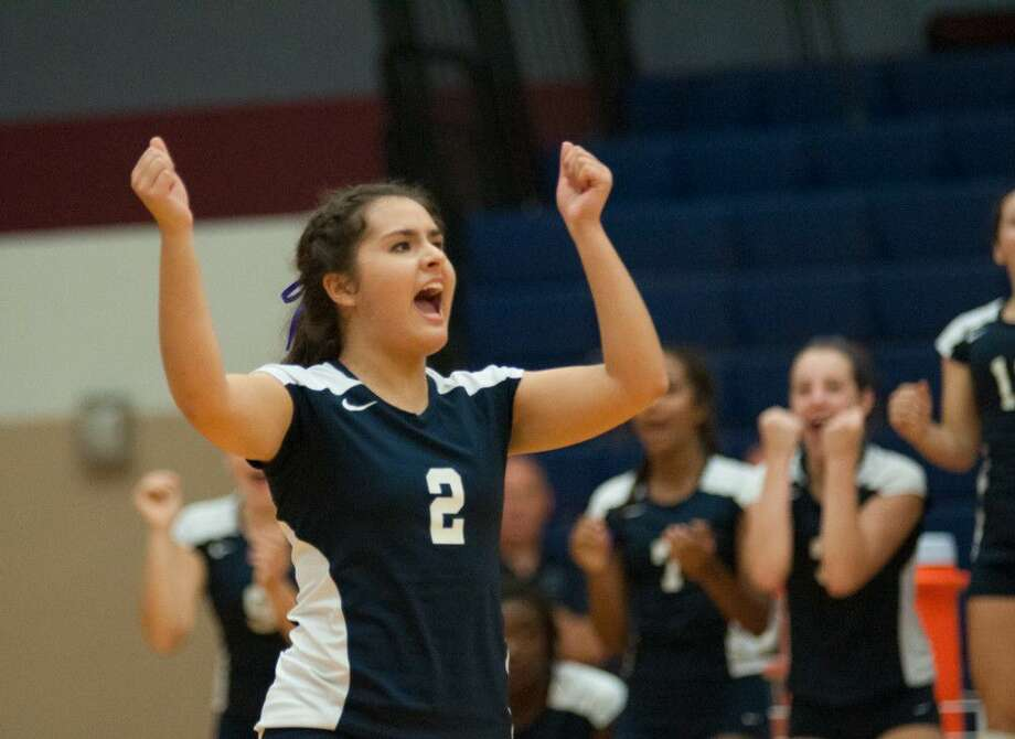 College Park's Alexis Martinez celebrates a point during a non-district match against Brenham on Tuesday at College Park High School.