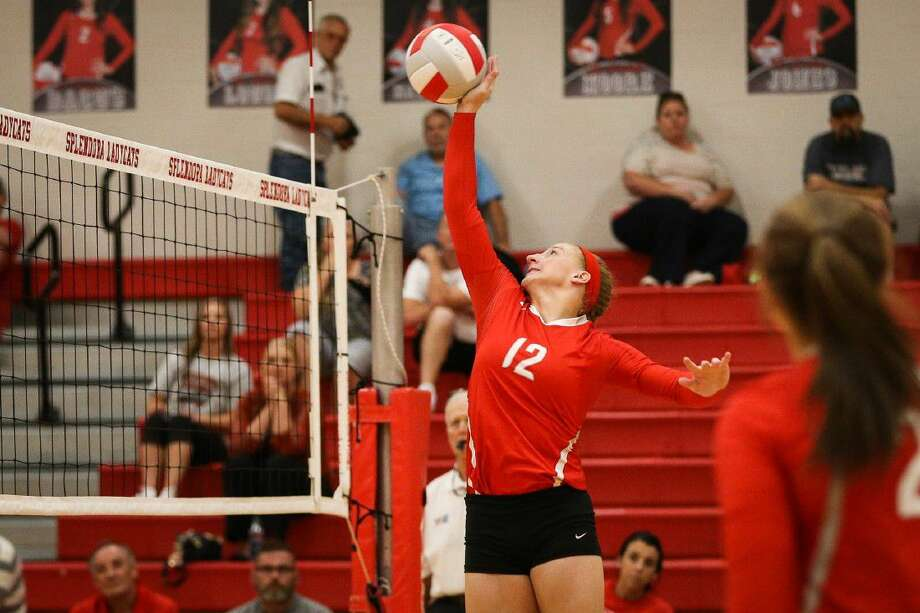Splendora's Savanna Parker (12) tips the ball over the net during the varsity volleyball game against Humble on Tuesday at Splendora High School. To view more photos from the game, go to HCNpics.com.