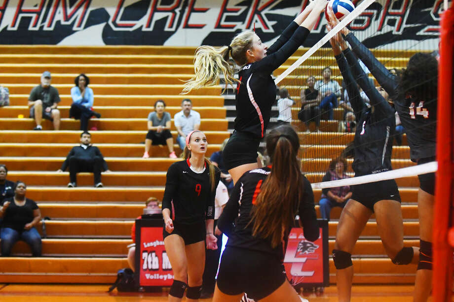 Langham Creek junior middle hitter Whitney Foreman is a physical presence for head coach Gena Rhodes and her Lady Lobos, as evidenced by this block against Cypress Lakes Tuesday. Foreman finished the game with eight kills and 11 digs. Photo: Tony Gaines