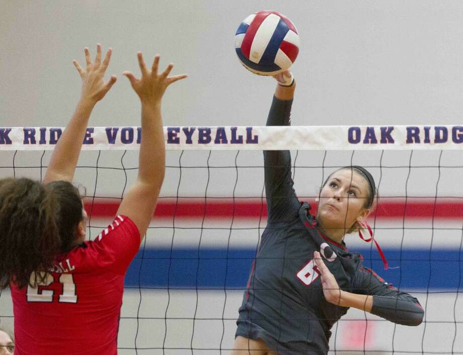 Oak Ridge's Molly Russell (6) gets a shot past Tomball blocker Victoria Putnam (21) during the second set of a non-district high school volleyball match last week.