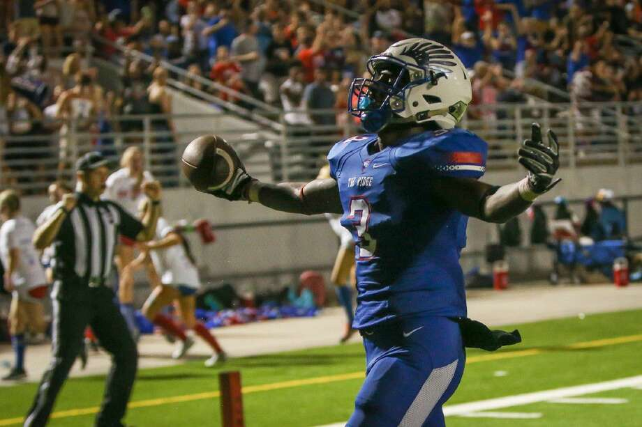 Oak Ridge's Kyle Townsend (3) celebrates while running into the end zone for a touchdown during third quarter of the varsity football game against Fort Bend Elkins on Friday, Sept. 2, 2016, at Woodforest Bank Stadium in Conroe, Texas.