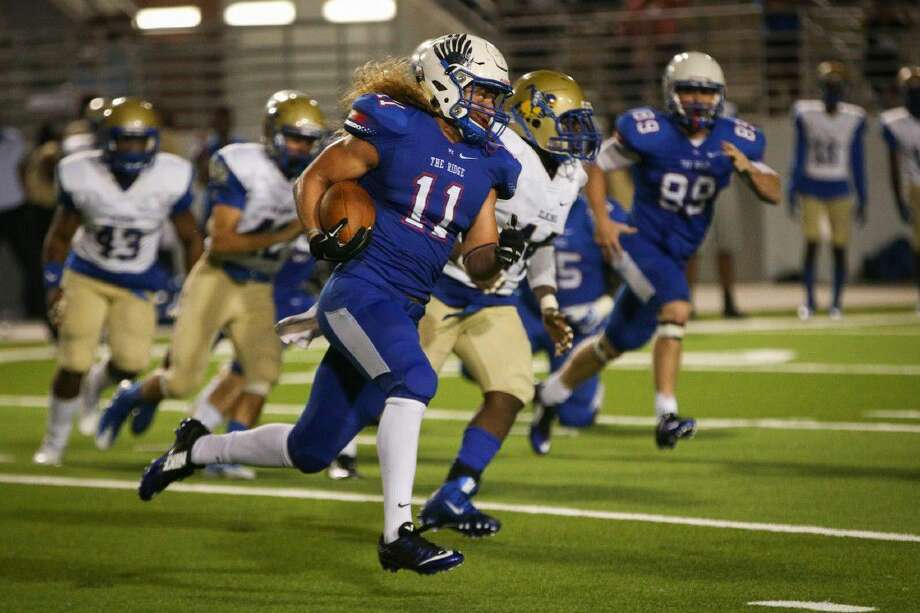 Oak Ridge's Grant Stuard (11) returns the ball during the varsity football game against Fort Bend Elkins on Friday.
