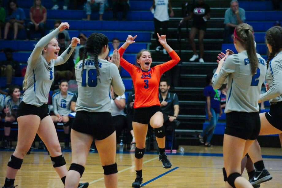 Members of the Clear Springs volleyball team celebrate a point against Dawson Tuesday night. Photo: Kirk Sides