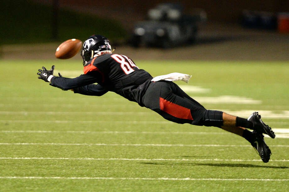 Ahmed Abdelrahman (84) of Ft. Bend Austin dives for a pass during the fourth quarter of a high school football game between Ft. Bend Austin and Kingwood on September 3, 2016 at Mercer Stadium, Sugar Land, TX. Photo: Craig Moseley