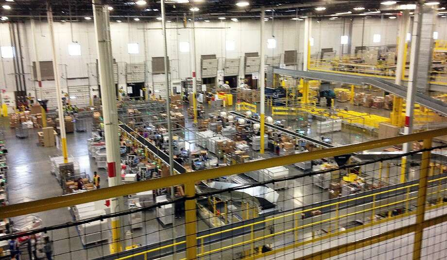 One of Amazon's distribution centers in Tracy, Calif., is shown in 2014. Amazon has announced it will build a new fulfillment center in Spring. The 855,000-square-foot facility will be located at the Pinto Business Park, off Interstate 45 and Beltway 8. Photo: Brandon Bailey