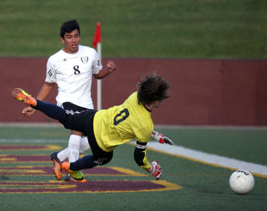 Oscar Cabello of Pasadena kicks the winning goal by the Cy-Springs goalie. Photo: Kar B Hlava