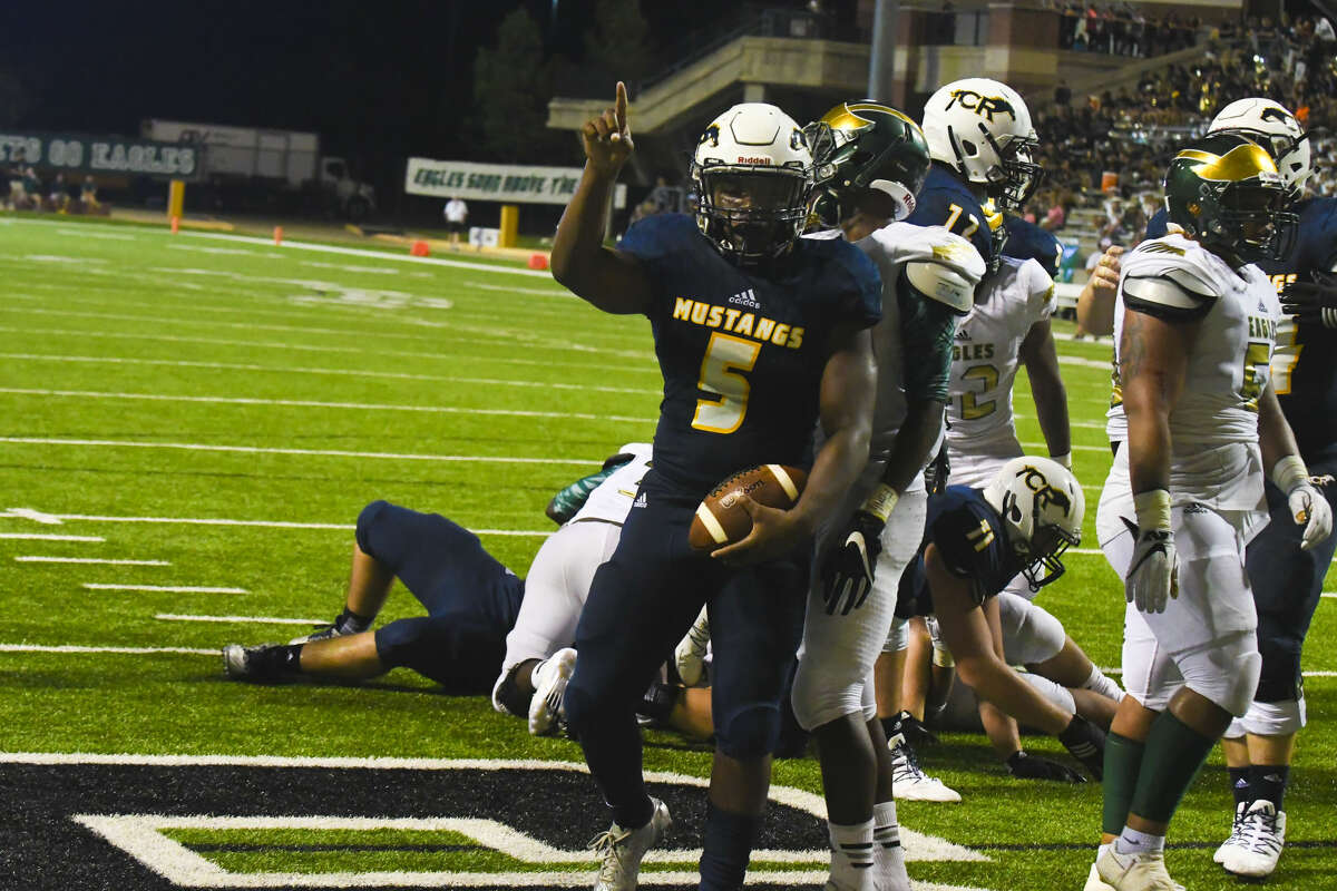 Cypress Ranch senior running back E.J. Thompson rushes for one of his two touchdowns against Cypress Falls.