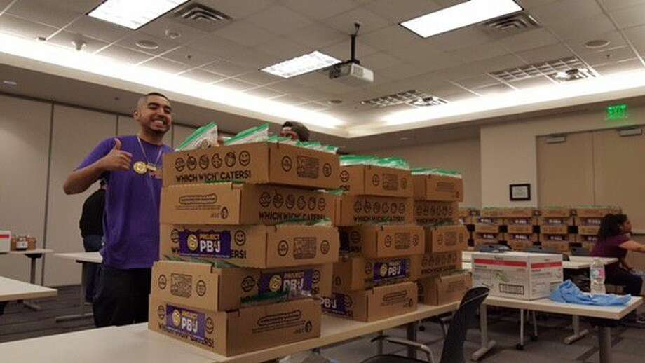 Julio Chavez, owner of Which Wich in Atascocita, gives the thumbs-up next to boxes of peanut butter and jelly sandwiches made by Which Wich employees and volunteers to be donated to local charitable organizations as a part of a National PB&J Day initiative on April 2.