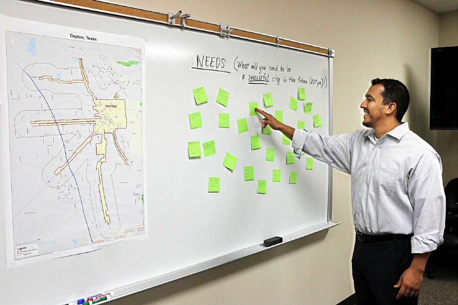Luis Nunez reviews some of the many comments already received from public officials and the citizens of Dayton as they plan development of the community for the future. Photo: David Taylor