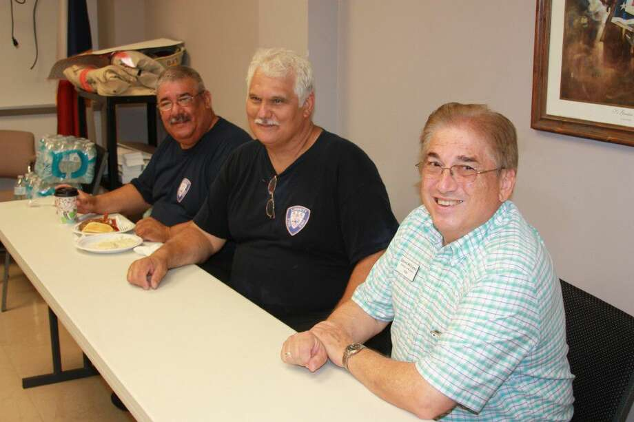 Liberty firefighters Oscar Cantu and John Thomas visit with David Williams, director of missions for Trinity River Baptist Association, at the Second Annual First Responders Breakfast. This year's event was held Friday, Sept. 9, at Liberty Fire Station. Photo: Vanesa Brashier