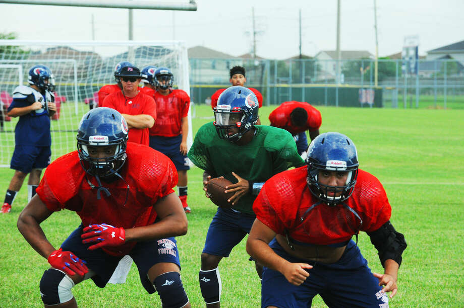 Cypress Springs junior quarterback Taye Barber runs the offense at practice Wednesday, September 7, 2016 at Cypress Springs High School. Barber believes wholeheartedly that he is the best quarterback in District 17-6A, but says that is largely due to terrific offensive line play and great performances from his receivers. Photo: Tony Gaines