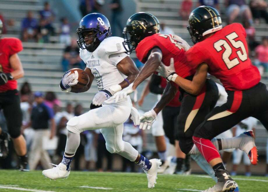 Humble's Jayshun Anderson runs for a touchdown against Caney Creek on Friday at Moorhead Stadium.