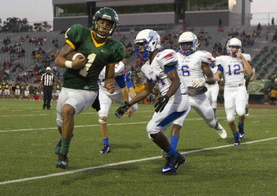 Klein Forest quarterback Kenneth Morris (1) runs for a 4-yard touchdown during the second quarter of a non-district high school football game Thursday at Klein Memorial Stadium in Spring.