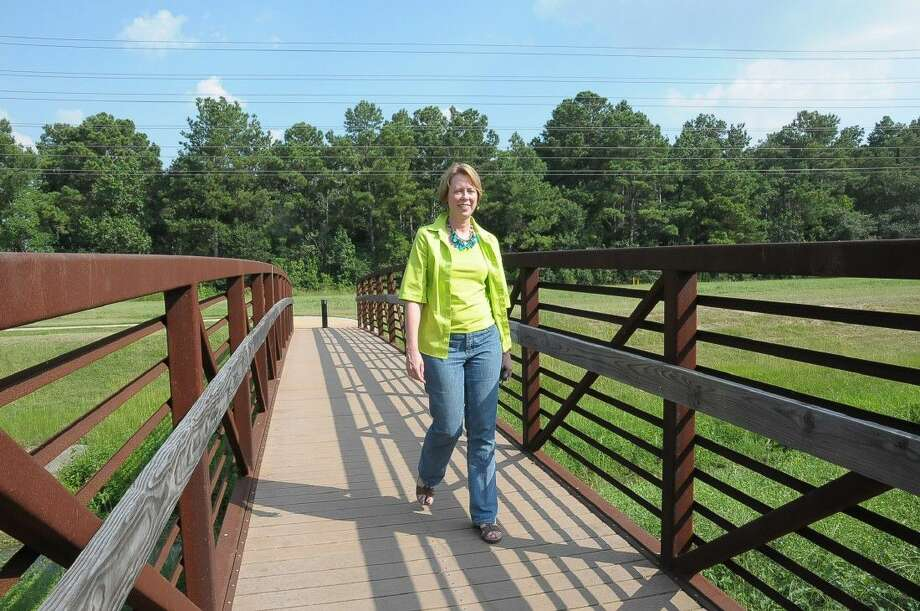 Greens Bayou Corridor Coalition is looking for a new executive director after former head Jill Boullion left for a leadership position at a local non-profit. Boullion is shown giving a tour of the pocket park in the Cutten Green subdivision in 2014 Photo: Freelance Photographer