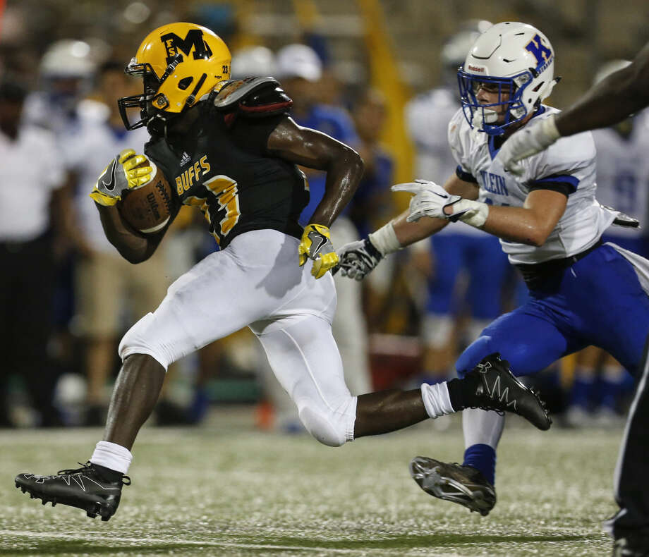 Fort Bend Marshall running back Jerry davis breaks through the Klein defense for a 58-yard touchtown run during the fourth quarter of a non-district high school football game at Hall Stadium on Thursday, Sept. 8, 2016, in Missouri City. ( Brett Coomer / Houston Chronicle ) Photo: Brett Coomer