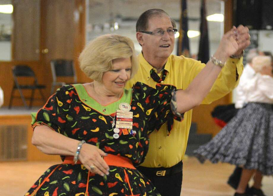 Charles Woody square dances with his wife, Twyla, during the Tomball Sesquicentennial Promenaders Square Dance Club dance at the Tomball VFW Post 2427 building, 14408 Alice Road. Photo: David Hopper