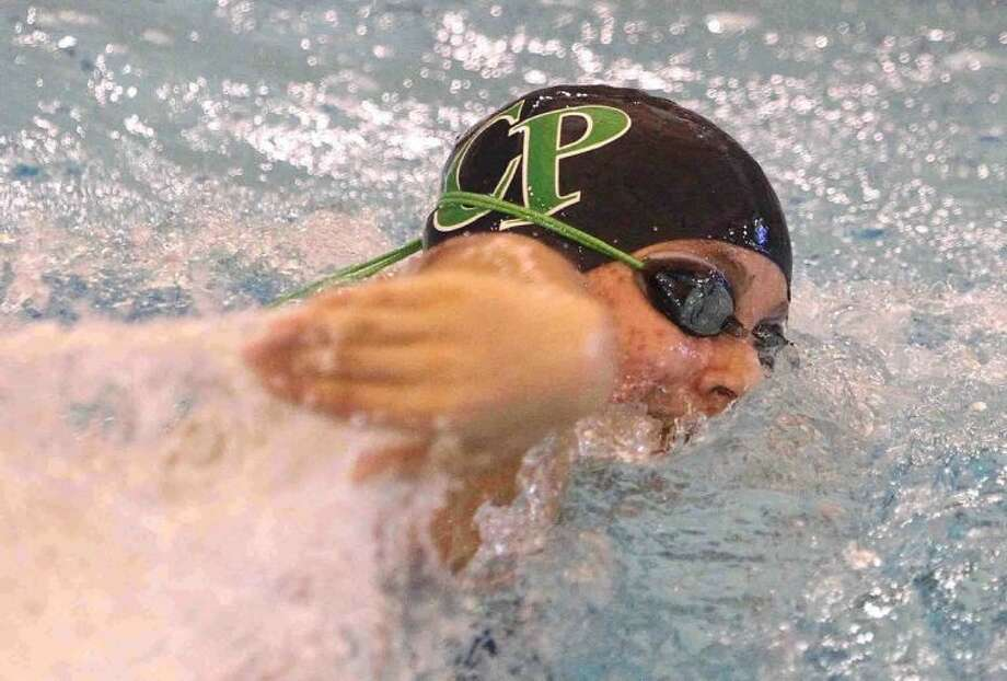 At left, College Park's Dorothy Halmy competes in the 500-yard freestyle.Below, Conroe's Kyle Briscoe competes in the 100-yard butterfly.