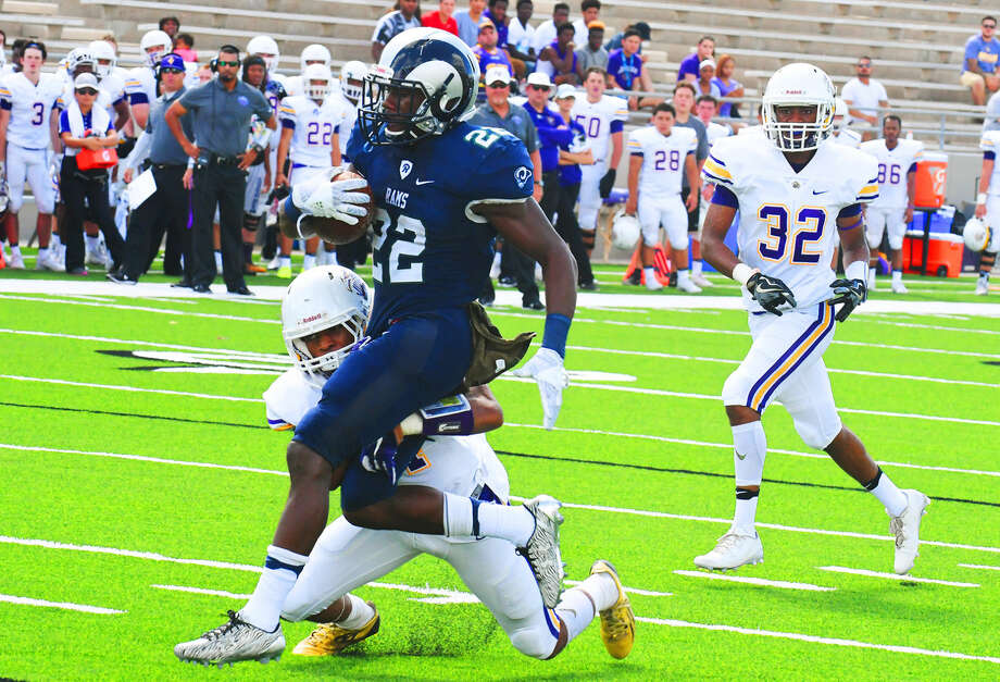 Cy-Ridge senior running back Trelon Smith enjoyed yet another superlative outing against Jersey Village Saturday at Ken Pridgeon Stadium. Smith finished the contest with 13 carries for 96 yards and three rushing touchdowns. Smith also caught two passes for 45 yards and one touchdown. Photo: Tony Gaines