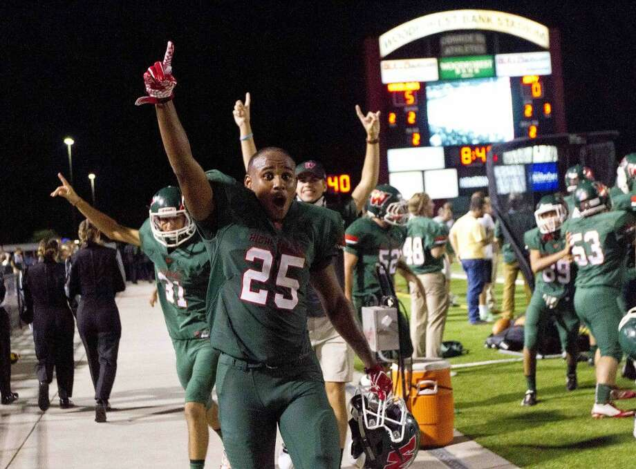 The Woodlands running back Jordan Talford (25) celebrates after defensive back Quinn Binney recovers a fumble by Katy quarterback Rocky Emery (12) during the second quarter of a non-district high school football game Friday at Woodforest Bank Stadium in Shenandoah.