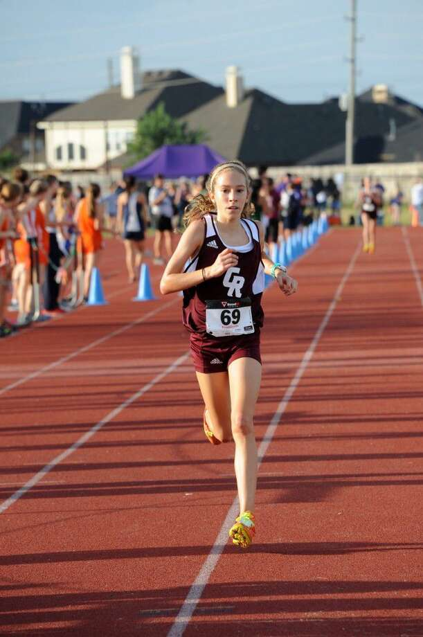 Cinco Ranch's Reagan Kappel ran a time of 18 minutes, 12.56 seconds to win the girls individual title and lead the Lady Cougars to the team championship at the Seven Lakes Showcase. Photo: Craig Moseley