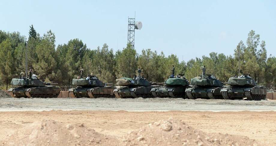 "Turkish tanks stationed near the Syrian border, in Karkamis, Turkey, Saturday, Sept. 3, 2016. Turkey's state-run news agency says Turkish tanks have entered Syria's Cobanbey district northeast of Aleppo in a ""new phase"" of the Euphrates Shield operation. Turkish tanks crossed into Syria Saturday to support Syrian rebels against the Islamic State group, according to the Anadolu news agency."