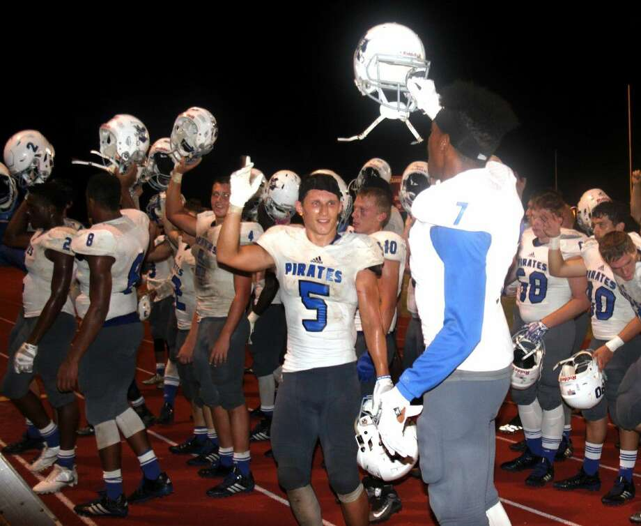 The Shepherd Pirates celebrate their victory over the Coldspring-Oakhurst Trojans. The last time the Pirates won the Battle of San Jacinto County was in 2004. Photo: Jacob McAdams