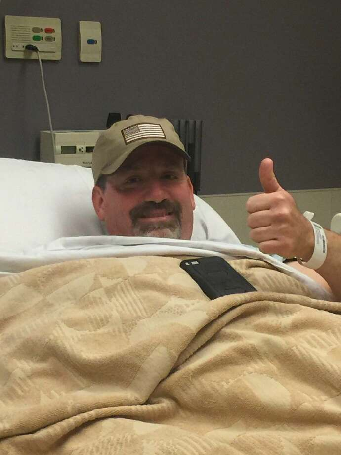Ninth state District Court Judge Phil Grant give a thumbs up from his hospital bed Monday. Grant broke his leg in a tubing accident on Lake Conroe over the Labor Day weekend.