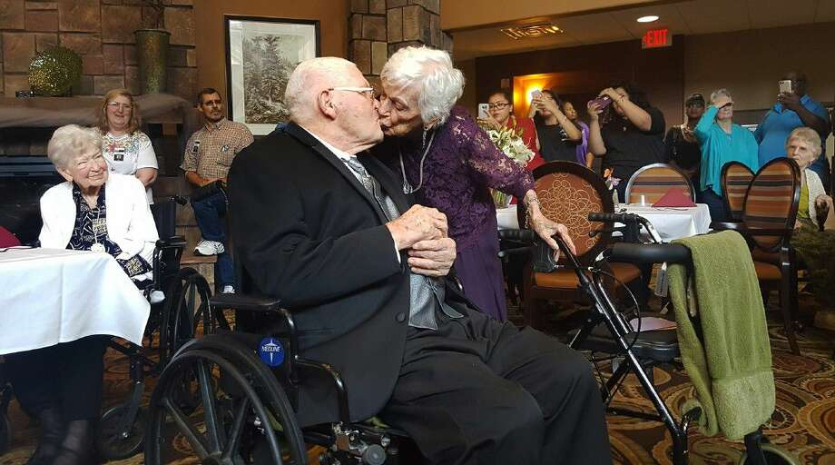 Bill and Margaret Stovall renew their wedding vows in front of family and fellow residents at Isle at Kingwood during their 75th anniversary party on Aug. 26. Photo: Melanie Feuk