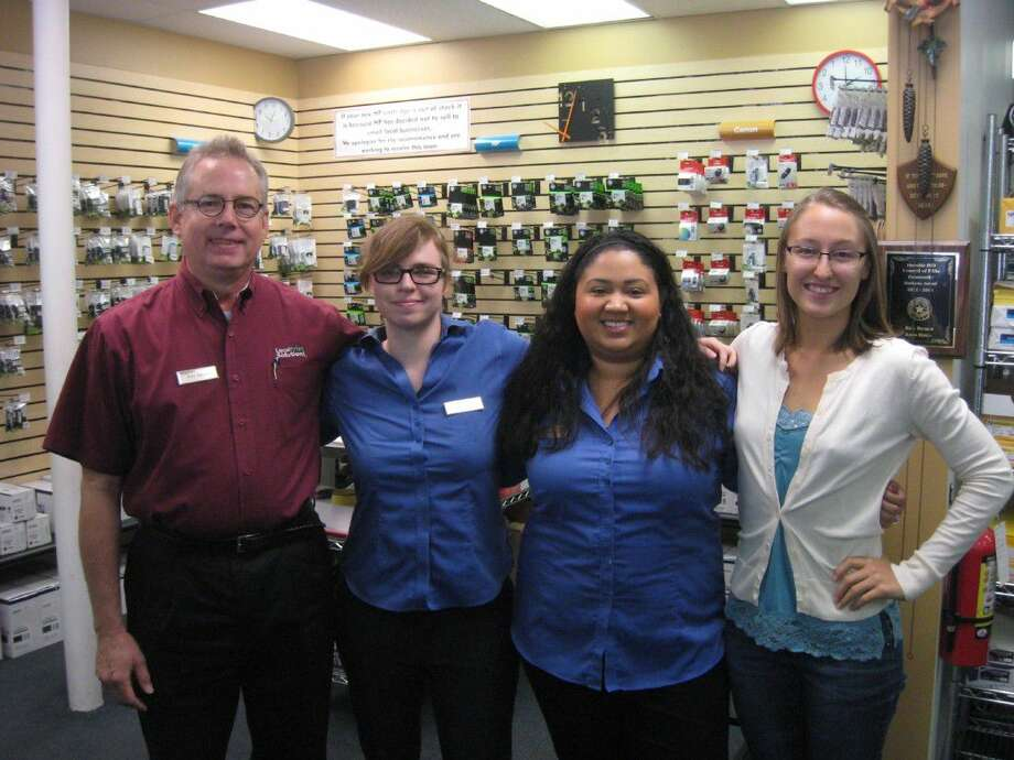 Ken Beard, left, with staff members at Local Print Solutions in Kingwood.