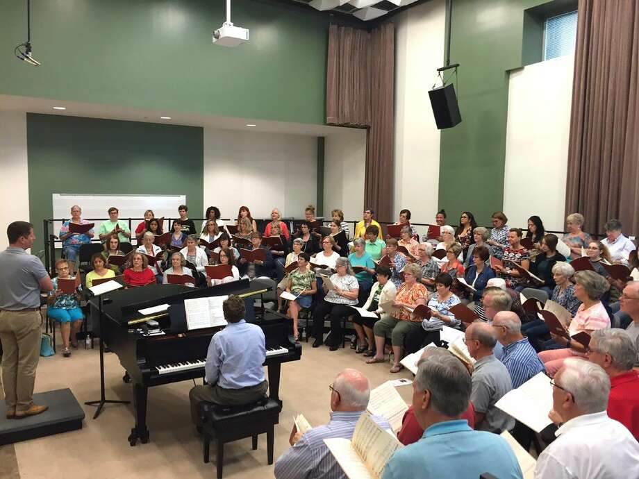 """Lake Houston area residents rehearse for the """"9/11 Concert of Remembrance and Peace"""" in LSC-Kingwood's Music Instructional Building. The concert will be on Sept. 11 at Strawbridge United Methodist Church in Kingwood."""