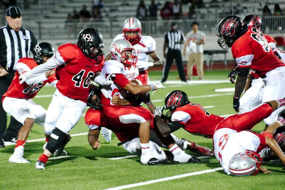 South Houston's Ethan Ponce (24) is wrapped up by Clear Brook's Devin Pope (40) Jonathan Daniel (45) and Nick Bailey (18) Friday at CCISD Challenger Columbia Stadium. Photo: Kirk Sides