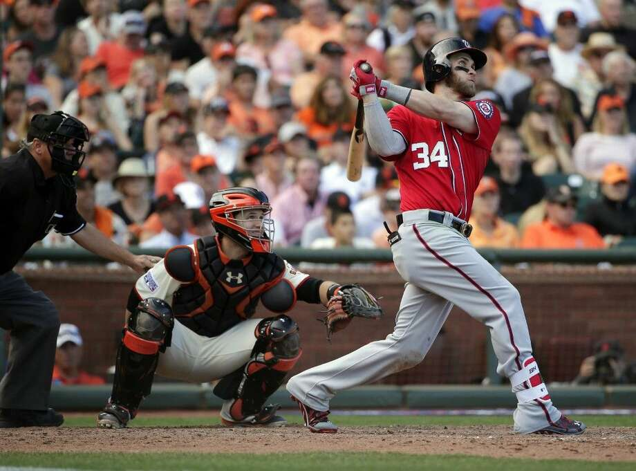 The Washington Nationals' Bryce Harper hits a solo home run in the ninth inning against the Giants. The Nationals won 4-1.