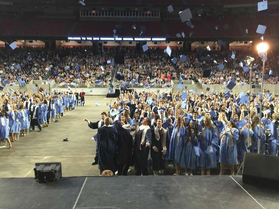 Humble ISD's Kingwood High School's, class of 2016 graduates throw their caps in the air during their graduation ceremony. Kingwood High School was the area's highest-scoring school in the U.S. News 2016 Best High Schools Rankings.