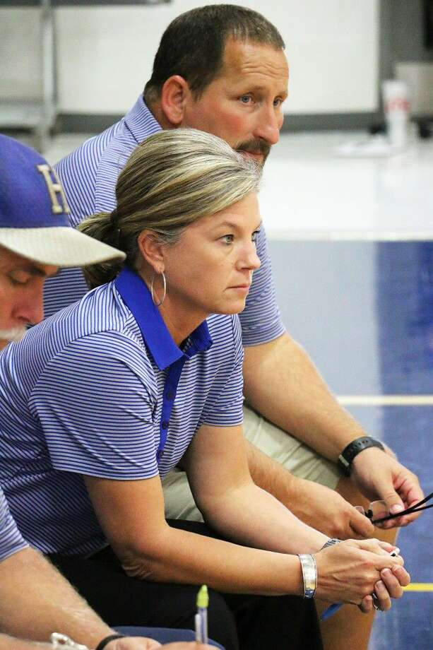 Hardin volleyball coach Regina Snell watches her team intensely during a match with her husband and fellow coach Randy by her side. Photo: David Taylor