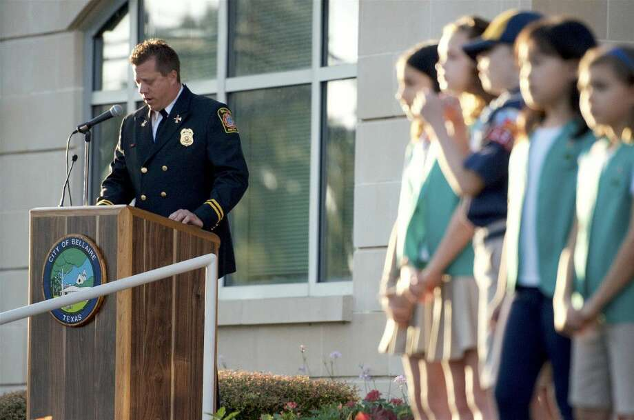 Deacon Tittel, Bellaire Fire Department commander, describes American Airlines Flight 11's crash into the North Tower of the World Trade Center during a ceremony remembering the 9/11 attacks Sunday. Various Girl Scout, Cub Scout and Boy Scout troops helped the department in the ceremony.