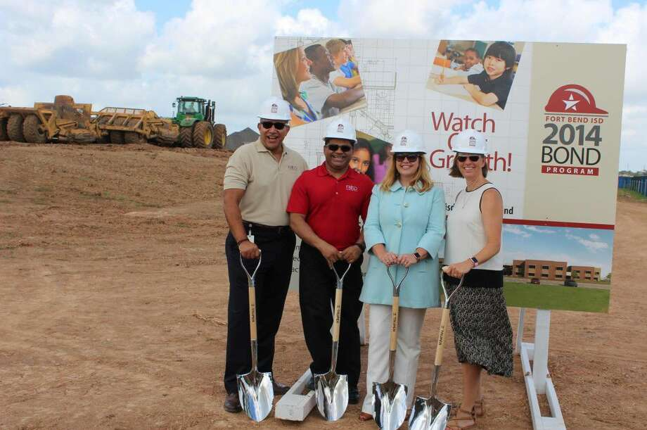 Work is underway on Elementary School No. 50 in the Fort Bend Independent School District. Among attendees at the recent groundbreaking in Grand Vista are, from left, Superintendent Charles Dupre and trustees KP George, Kristin Tassin and Grayle James. Photo: Fort Bend ISD