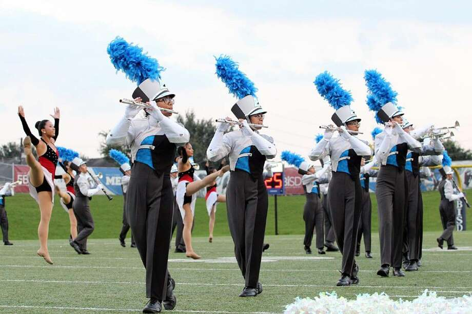 """The S.F. Austin High School Bulldog Marching Band and Angels Dance Team perform this year's show """"Summertime!"""" Photo: Nancy Lubrano"""