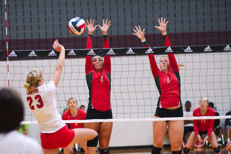 The Woodlands' Kendall Cook (4) and Rachel Reed (8) try to block a shot at the net during the Adidas Texas Volleyball invitational tournament Friday, Aug. 15. Photo: Staff Photo By Kirk Sides