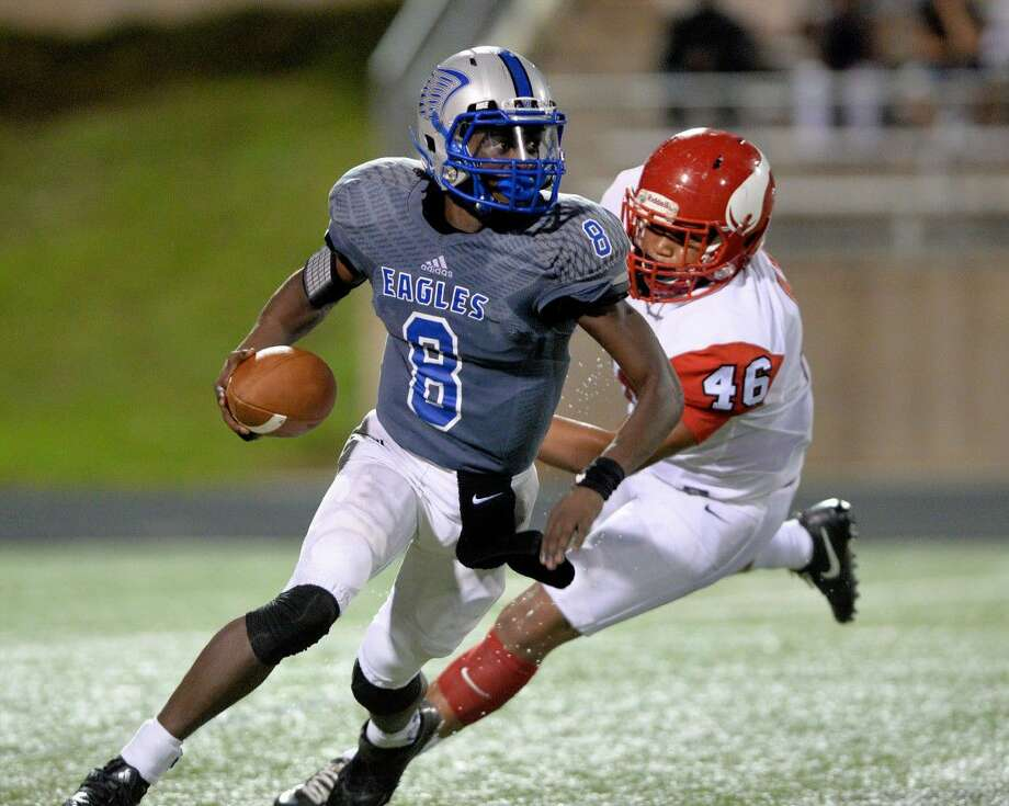 Willowridge quarterback Kealton Goffney (8) is pressured by Terrance Williams (46) of Dulles in the third quarter of a high school football game between the Willowridge Eagles and Dulles Vikings on September 10, 2016 at Hall Stadium, Missouri City, TX. Photo: Craig Moseley
