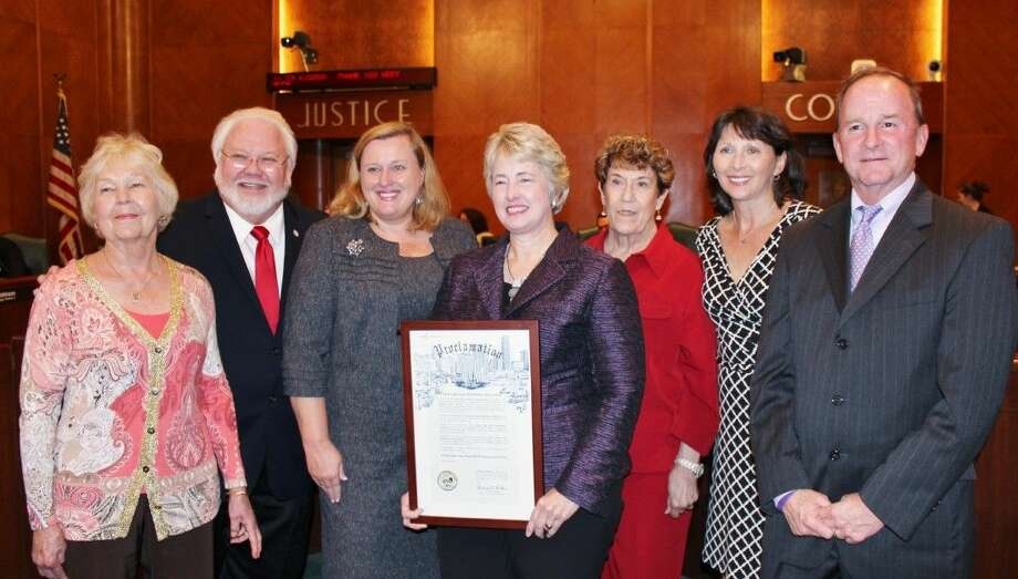 Left to right: Karlee Marcom, founder/charter member; Houston City Councilman Michael Kubosh; Panhellenic President Kim Barker; Mayor Annise Parker; Ruth Beecher; Barbara Dickey; and Houston City Councilman Dave Martin.