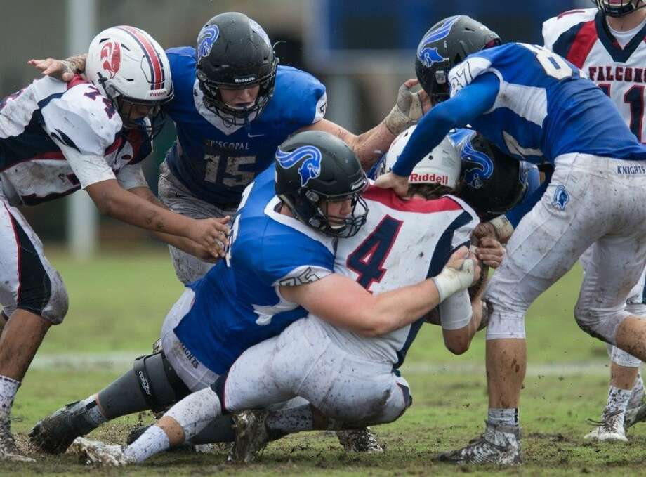 Walker Little (75), Gavin Geib (15), Matthew Leggett (87) and the Episcopal defense held opponents to 21.7 points per game during a 9-2 season last fall. Even with Geib starting at quarterback this year, the Knights have held their first three opponents to an average of 16 points. Photo: Kevin Long/GulfCoastShots.com