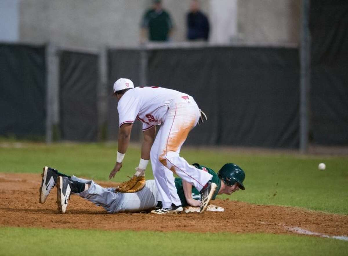 A St. Thomas first baseman watches a pickoff throw get away during the Eagles recent game against Strake Jesuit. The Eagles will be one of the hosts of their annual Father Wilson/Sister Julia tournament, which begins Thursday morning at four different sites on the north side of the city.