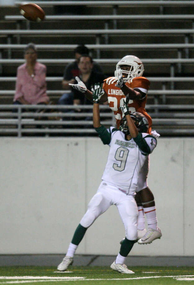 Dobie wide receiver Kaelon Woods (26) goes up over Jorge Pena (2) of Pasadena for the catch. Photo: Staff Photo Kar B Hlava
