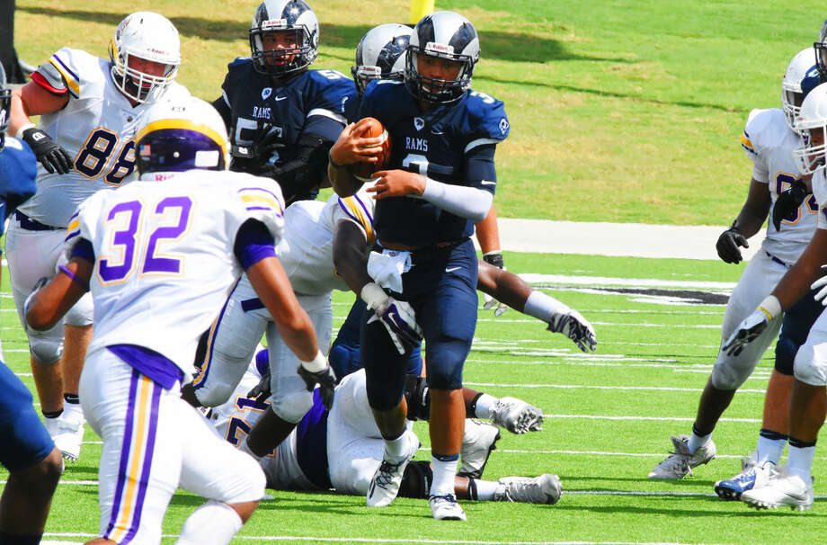 Cy-Ridge senior quarterback Tyson Williams had one of the standout performances of the first week of district play, completing 14 of his 15 pass attempts for 181 yards and two touchdowns in a 60-28 victory against Jersey Village. Photo: Tony Gaines