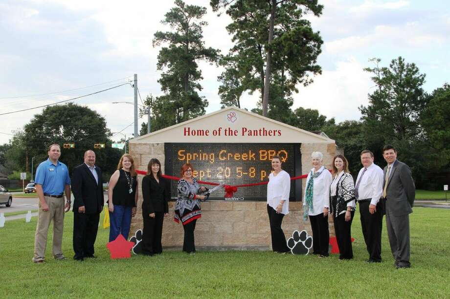 Representatives gathered outside of the school Sept. 12 to celebrate a ribbon cutting ceremony for the electronic sign which was made possible by donations from the Pine Forest Elementary PTA, Pine Forest Panther Parents and Primrose School of Atascocita.