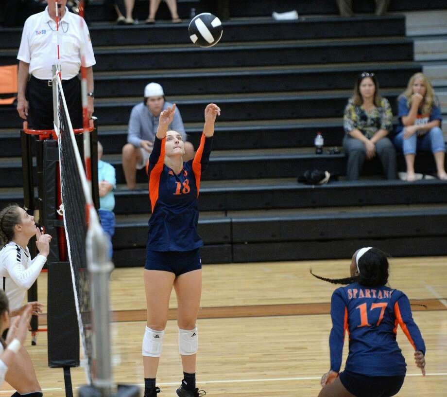 Camille Conner (18) of Seven Lakes sets the ball for Beryl Edem (17) during the fourth set of a non-district volleyball game between the Seven Lakes Spartans and Foster Falcons on September 6, 2016 at Foster High School, Richmond, TX. Conner, a senior, is committed to play for Texas A&M in 2017. Photo: Craig Moseley